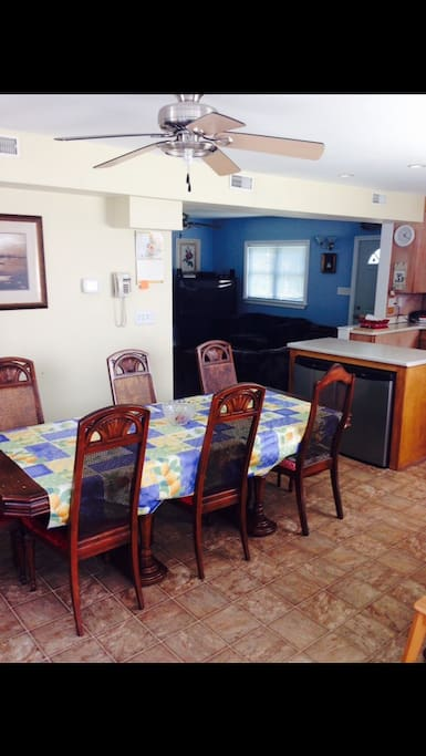 Large spacious open concept kitchen and dining  area with 2 built in island bar fridges