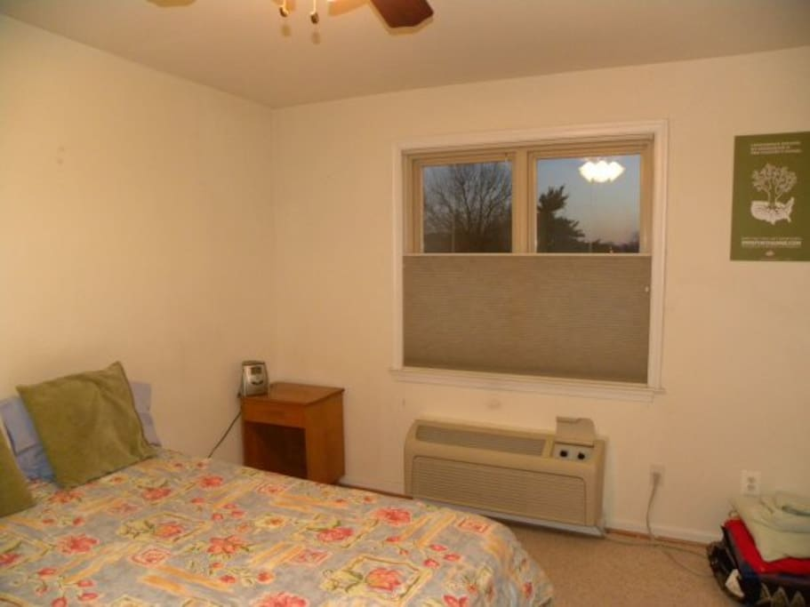 bedroom has full-sized bed. Also double combed blinds open from top or bottom for privacy & light.