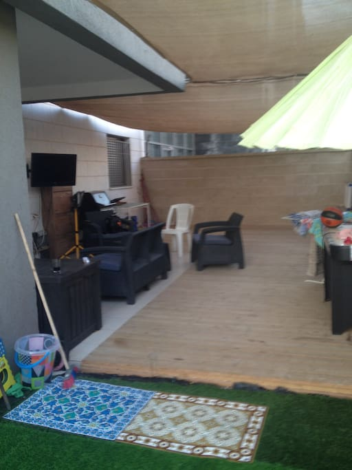 130 SF of wooden deck include grill, lighting & shading - perfect for BBQ afternoon.