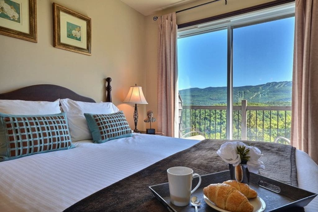 Master bedroom with king bed, en-suite bathroom, private balcony and great views of the surrounding mountains