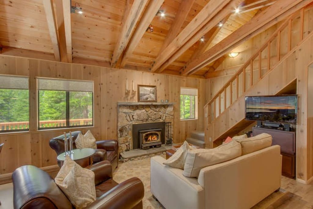 Living Room w/Vaulted Ceilings, Large Windows, Fireplace, & Large Flat Screen TV