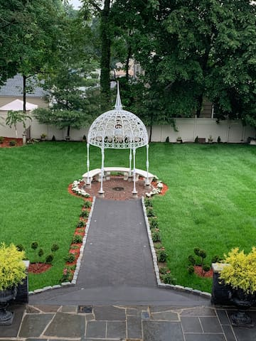 Gazebo in secluded garden for small get together