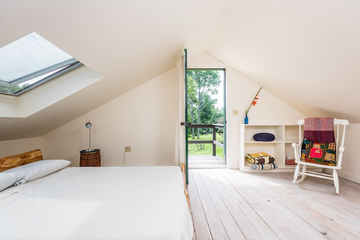 Private queen bedroom opens onto a small landing with great views of the property- and has a second entrance for this room alone.