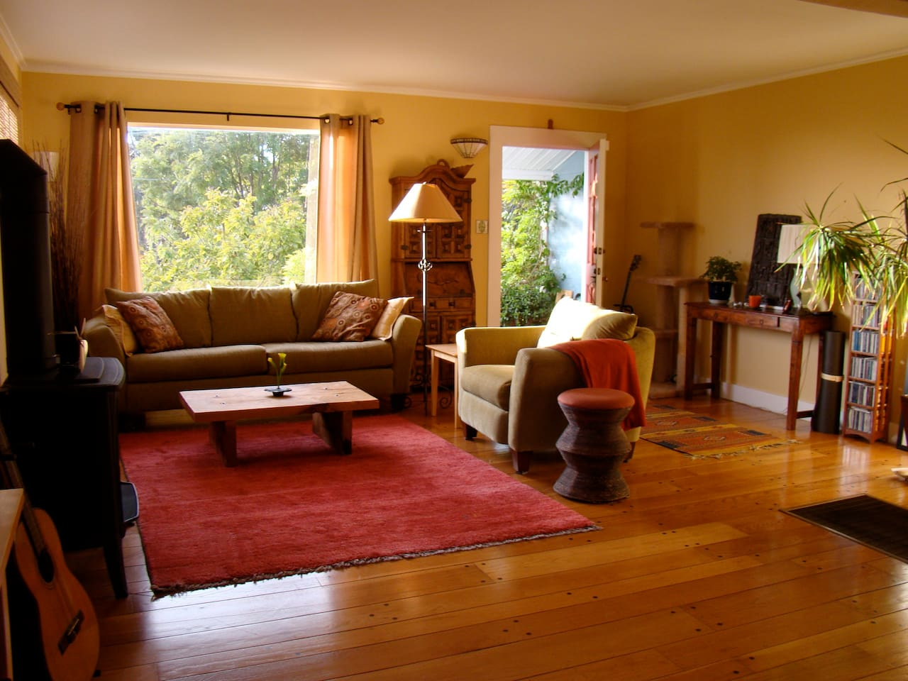 Living room with view of north bays, beautiful sunsets  and gas fireplace