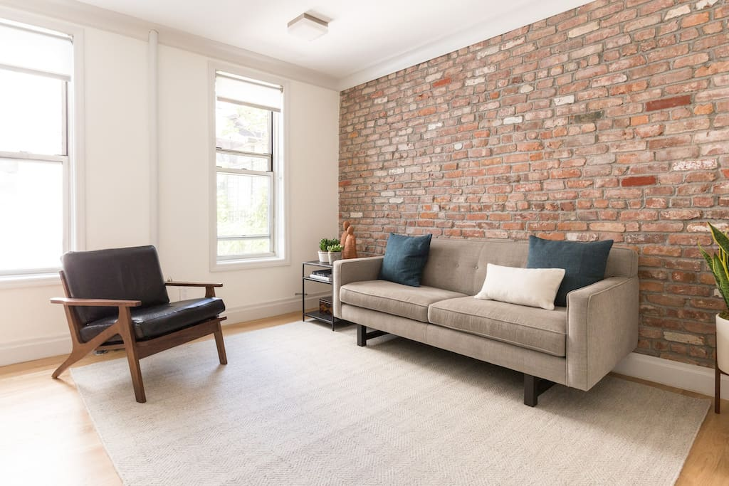 High ceilings and two large living room windows offer great light with plenty of peace and quiet.