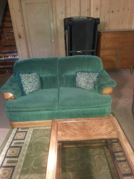 Another love seat, treadmill and dresser