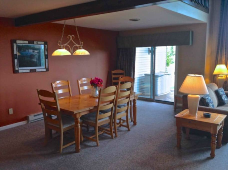 dining room on main floor with sliding door access to deck