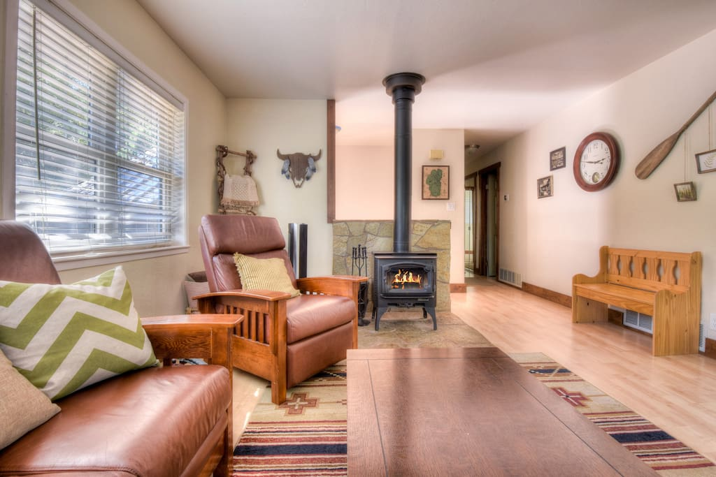 Living room with stove and beautiful Tahoe decor
