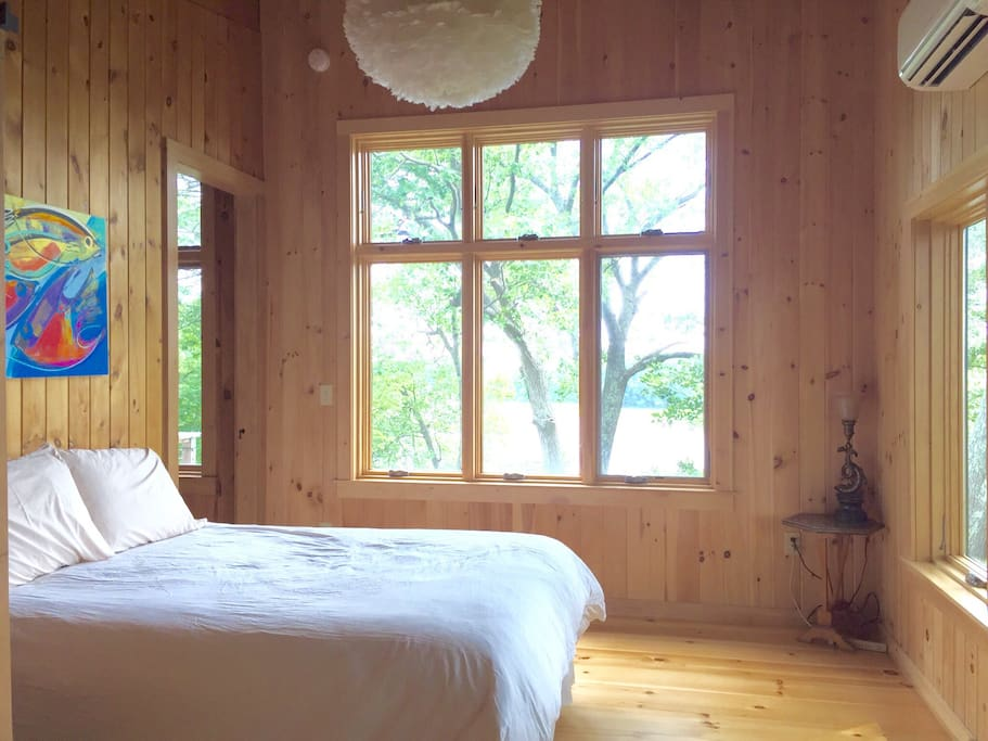 Master bedroom has a tree house feel with spectacular views.