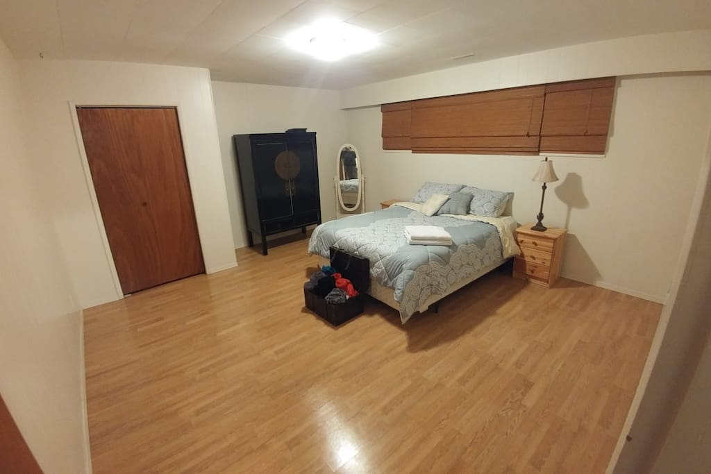 Large bedroom with Queen size pillow top mattress bed, closet & dresser.