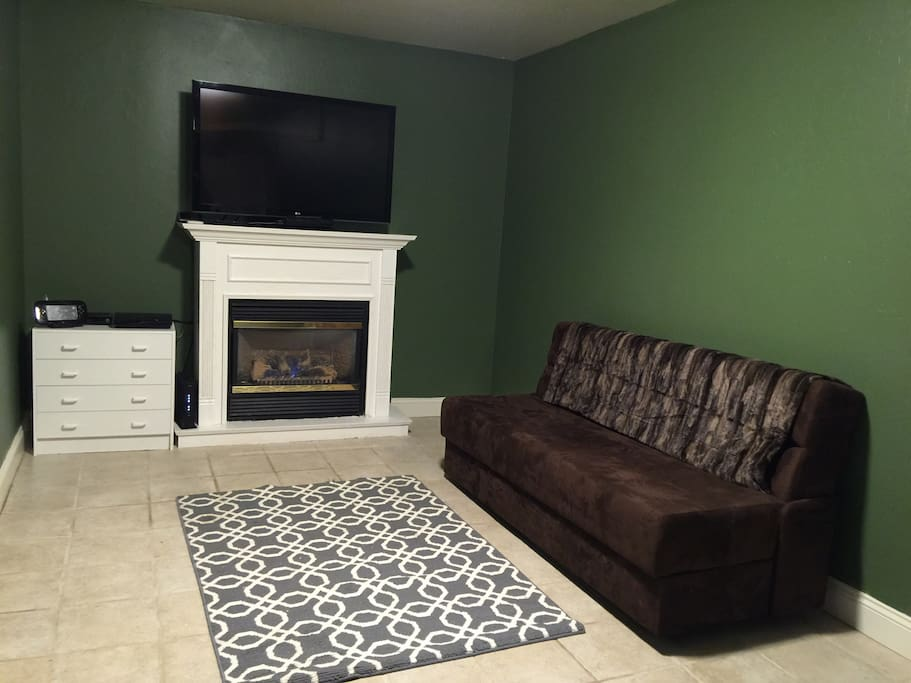 The HD TV with cable, wireless internet, a gas fireplace and game consoles are all available in this connected living area.  The sofa futon folds down into a full size bed and can sleep one adult or two children.  A washer and dryer are also located in this area (not shown).