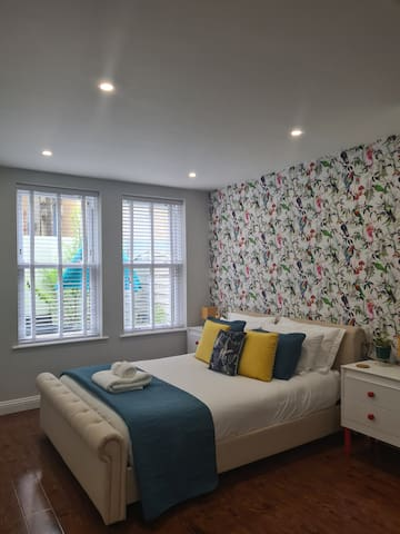 The bedroom area with a king size bed