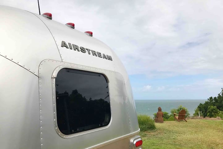 Groovy American van - above beach + secluded luxe