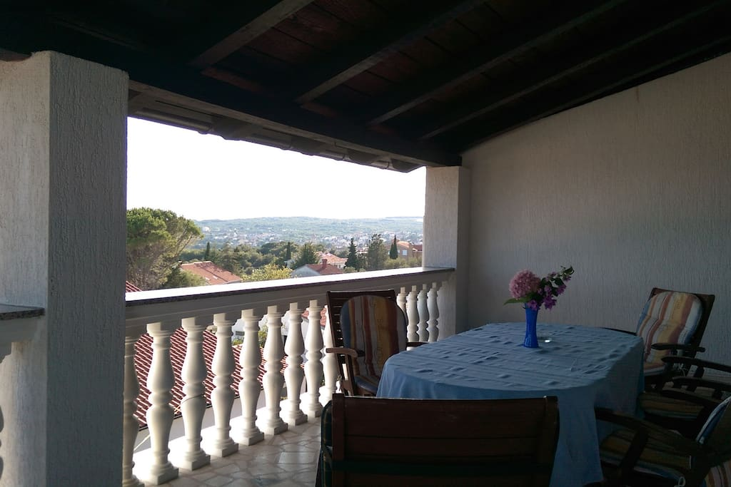 Spacious under roof terrace with a stunning view of the bay and the town of Krk