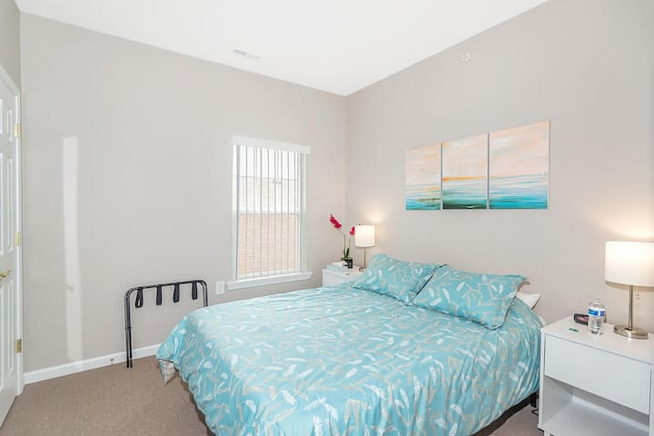 Bedroom 2 is a bit smaller, but has a closet, dresser, and plenty of lighting, too.