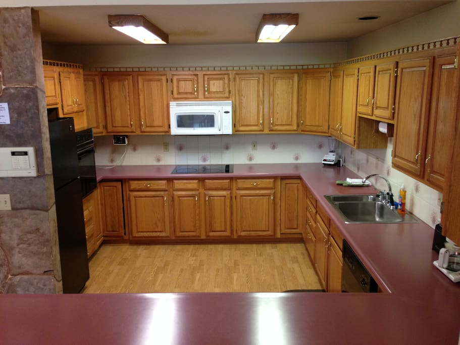 Full kitchen with all supplies to cook and  eat