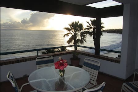 One of A Kind Resort!  Modern apartment downtown on the ocean! Sleeps 4, 2 full baths.  2 blocks walk to galleries, restaurants, boutiques.  Drive to Disneyland, San Diego, Los Angeles. Parking included. No extra fees.  You'll come back every year!