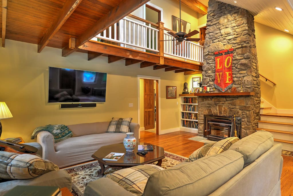 This stunning 3,100-square-foot property sleeps 12 and boasts a rustically-themed interior along with a home theater room!