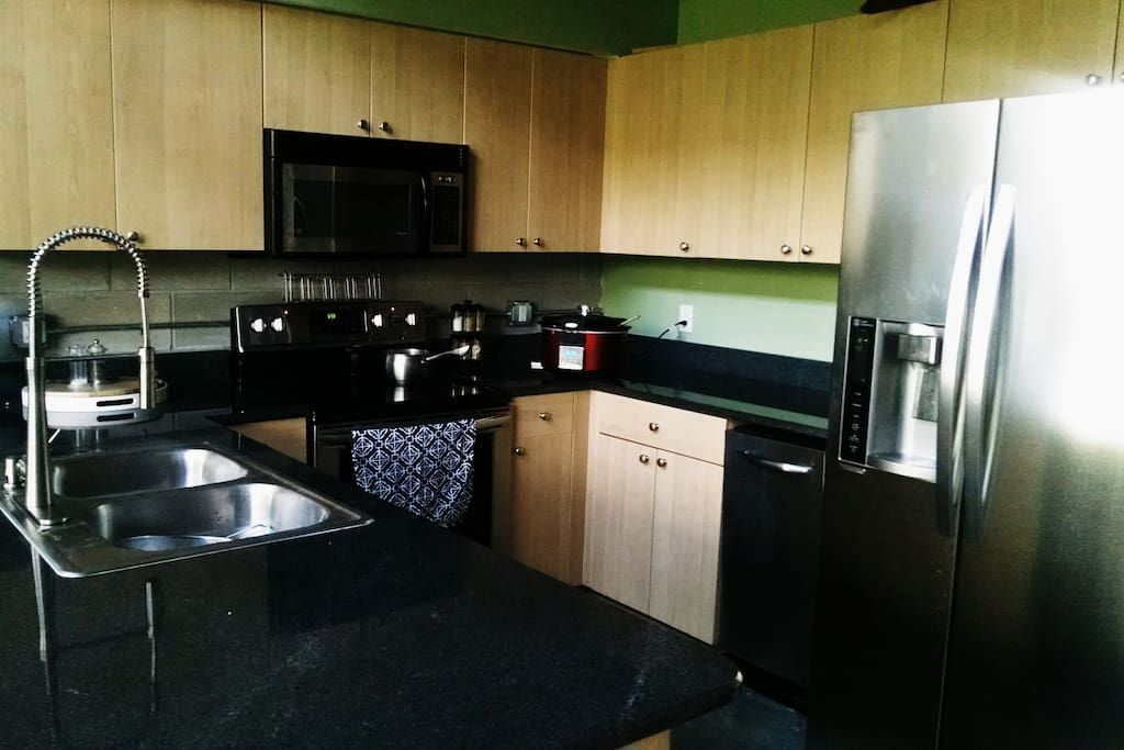 Brand new stainless steel kitchen with granite countertops