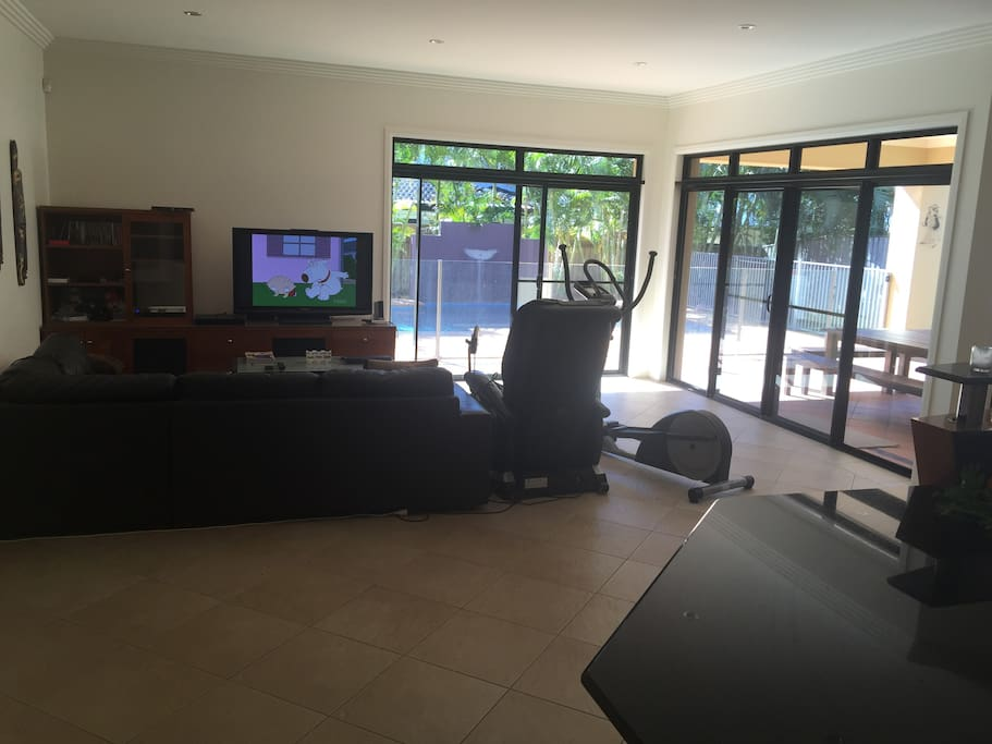 Downstairs Lounge Area (Open Plan - access to pool etc)