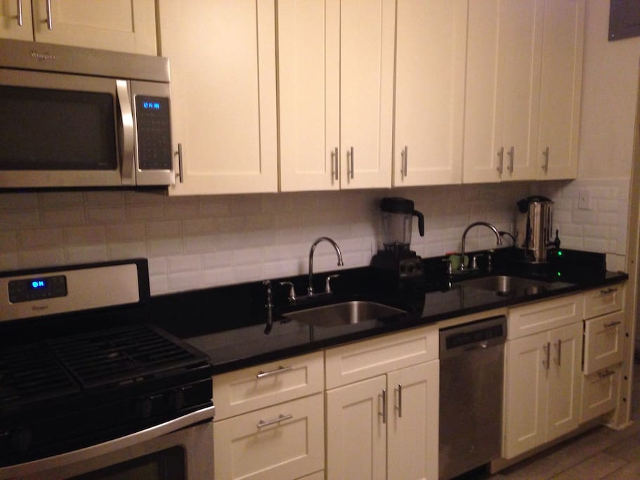 Luxury kitchen with granite counter top, dishwasher and microwave