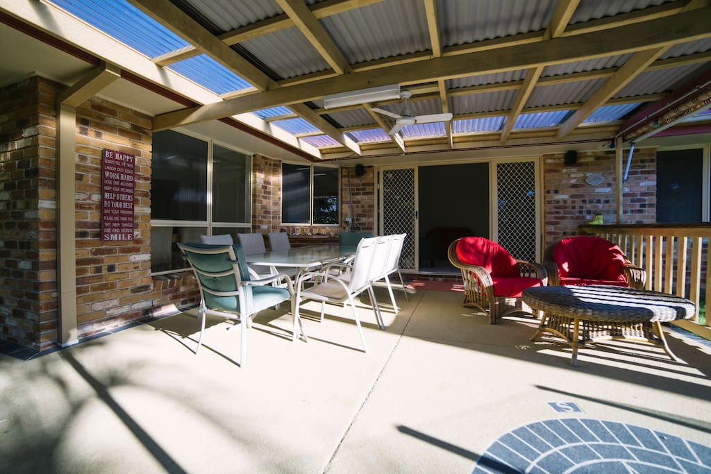 Outdoor area - table seats 8. Relaxing chairs to enjoy watching kids in pool or enjoying the fire.