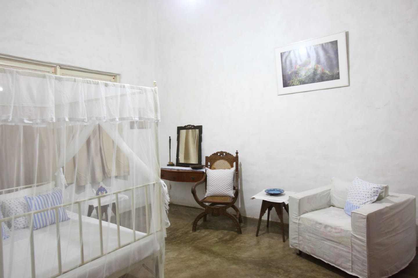 the double bedroom with antique sri lankan furniture
