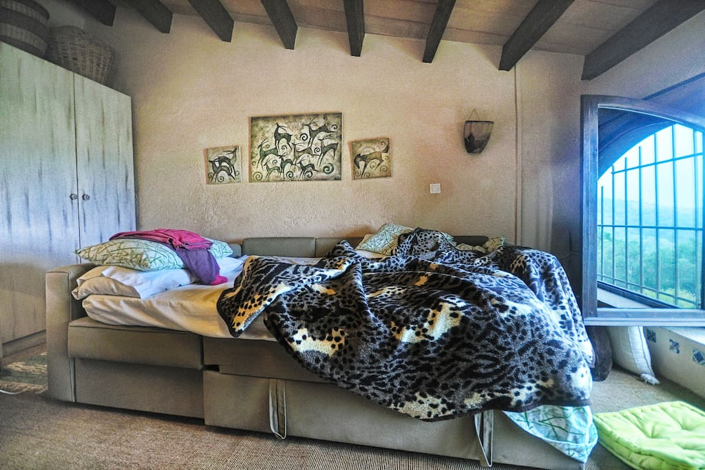 Large double bed catches the sunset and views of the valley in Can Torras Studio