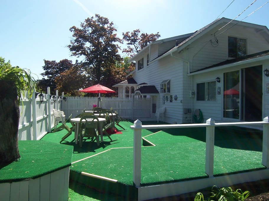 Large deck with plenty of tables, chairs and deluxe BBQ grill