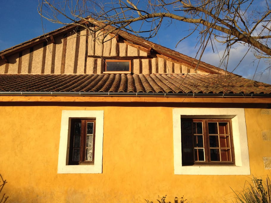 House is Gascony style with mustard colors and oak beams