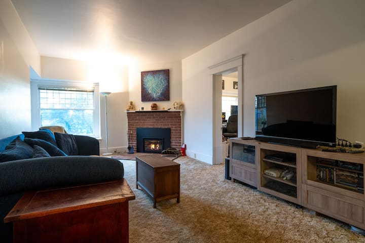 Living room with big comfy couch, touch start fireplace, and all the Netflix you wish.