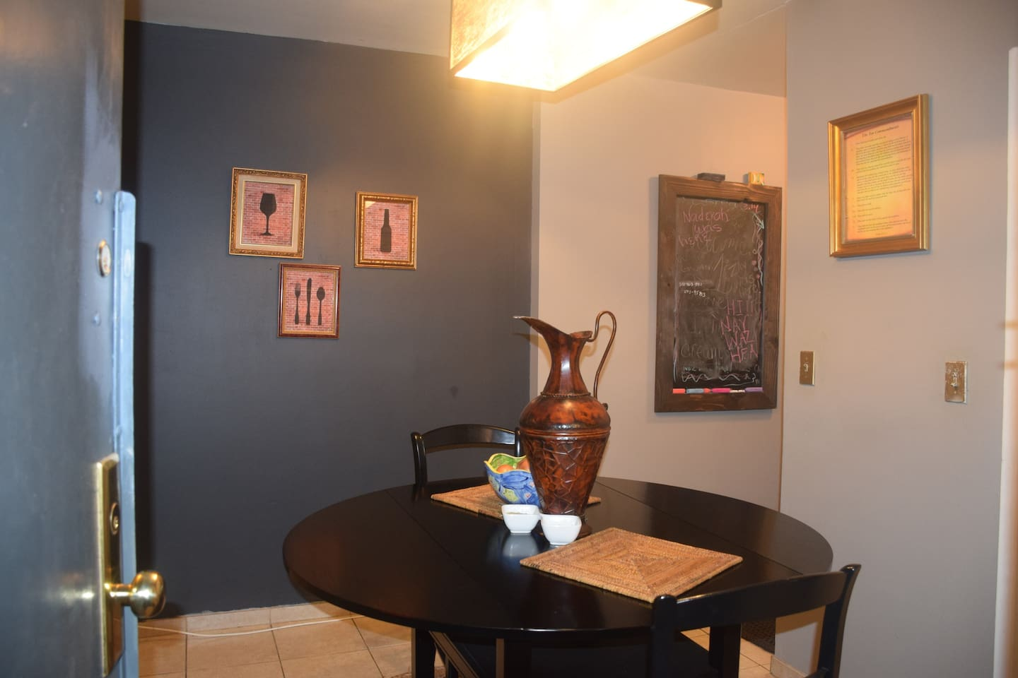 entrance into the apartment, dining table opened to seat 4