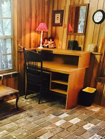 Desk in the den for computer work or writing. The flooring in the den is brick and came from the downtown train depot.(historic)