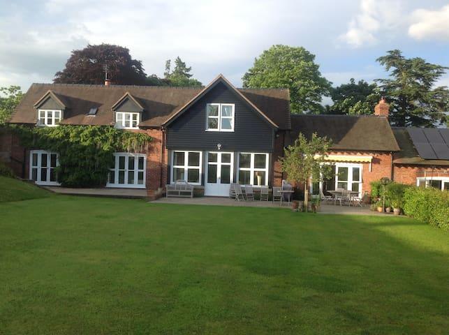 Large en-suite double room in Shropshire Hills.
