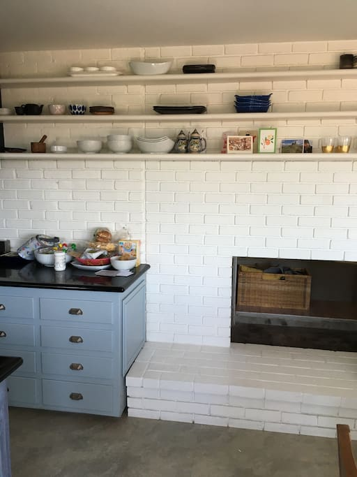 Fireplace connects kitchen and living room