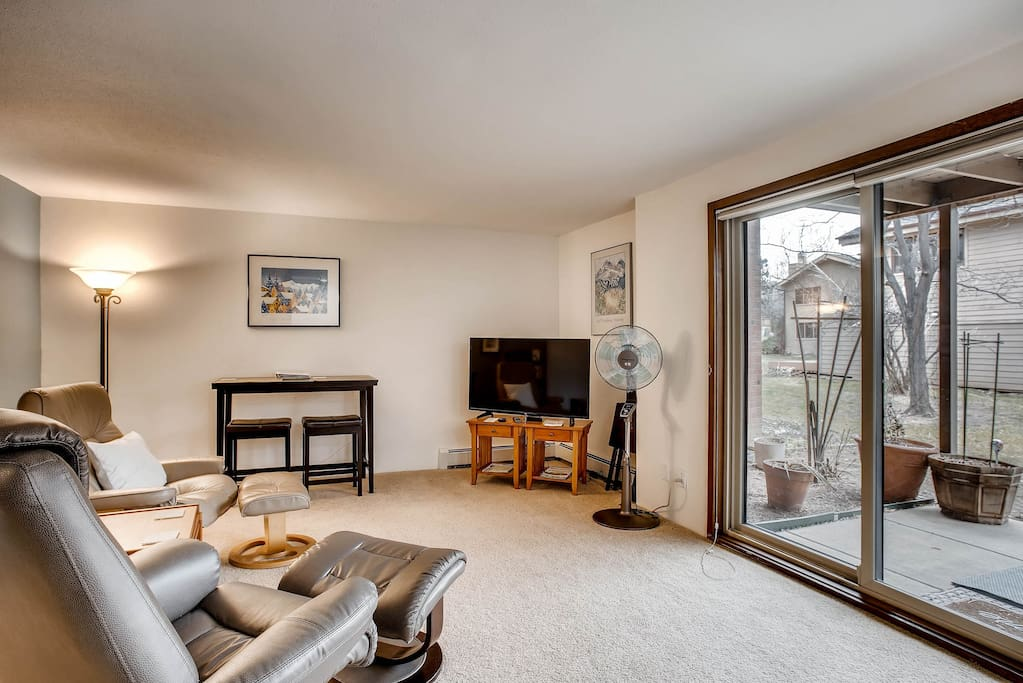 """Private Living Area- Swedish style lounge chairs, work table, high speed unlimited data wifi, digital antenna tv service and new 42"""" LED TV."""