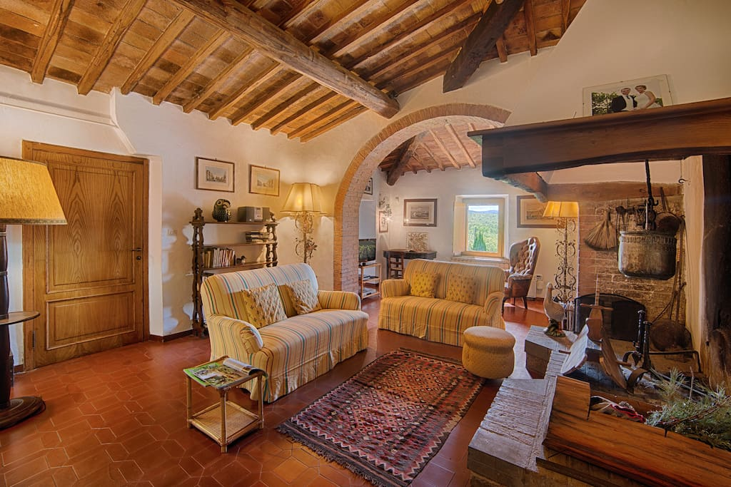 Cozy living room with typical Tuscan fireplace.