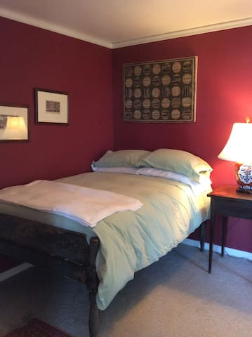 Second bedroom with double bed on main floor.