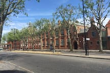 The recently refurbished exterior of the 500 year old Highgate School is a few moments up the road