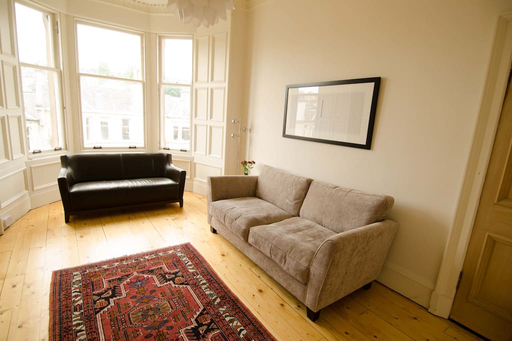 The sitting room has two comfortable sofas.