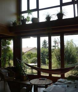maison bioclimatique bois près Lyon - Saint-Laurent-d'Agny - Hus