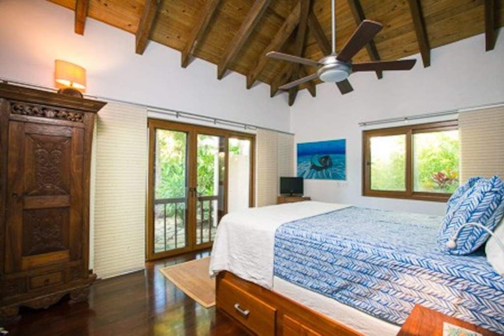 Master bedroom #2 with en suite bath, garden and sea views, and doors to the outdoor shower and palapa.