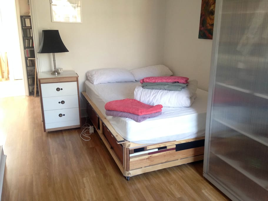 Bedroom with large double bed. All Bedding and towels are provided.