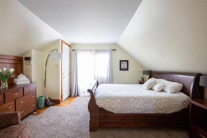 Large bedroom with comfy king size bed.