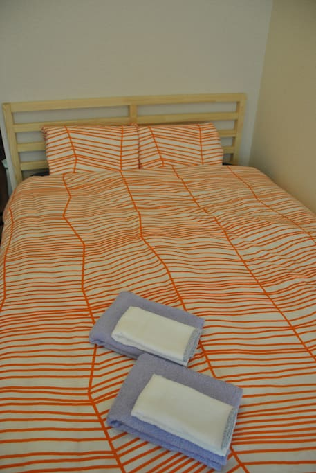 Queen size bed with Hovag Mattress from Ikea