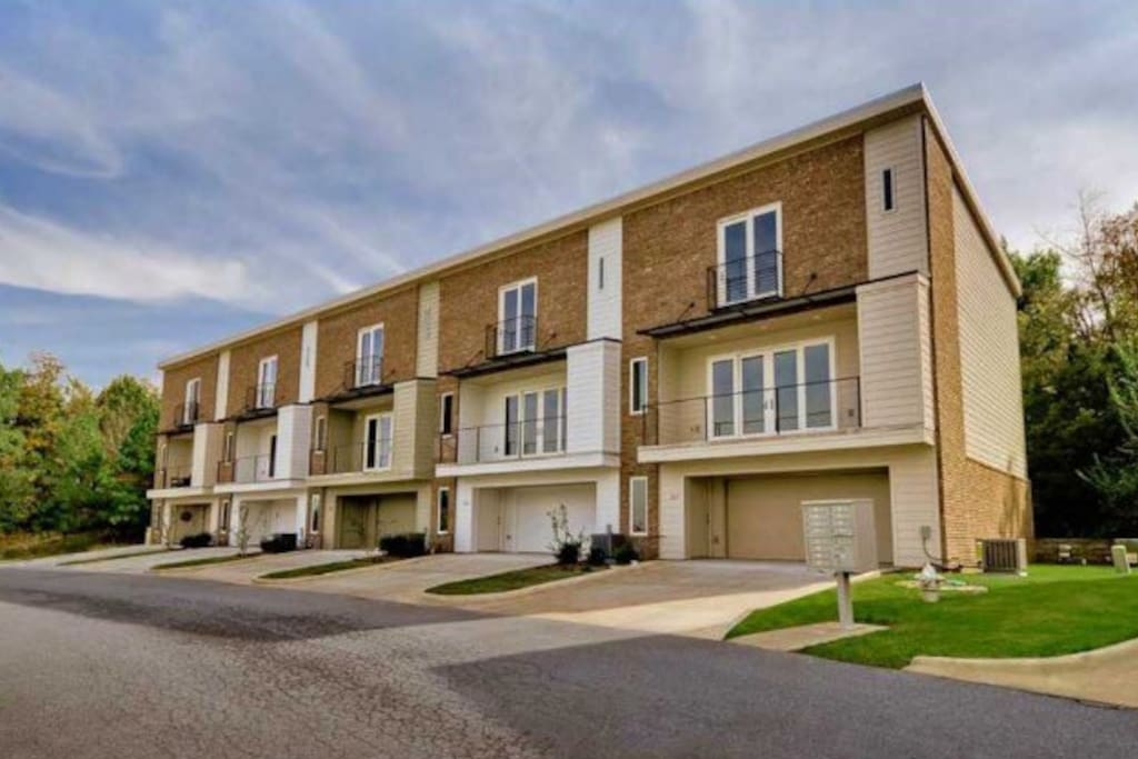 Three story 2,005 sq ft townhome on private lane (end unit on the far right next to green grass)