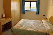 Airconditioned. King size bed and enjoys some sea views.