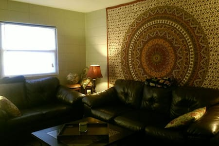 Right on FSU campus. Walking distance to stadium.  2 comfortable couches available in spacious living room. I also have an air mattress. Living room has access to kitchen and full bathroom. Wii and TV available. Laundry on site. Mi casa es su casa!