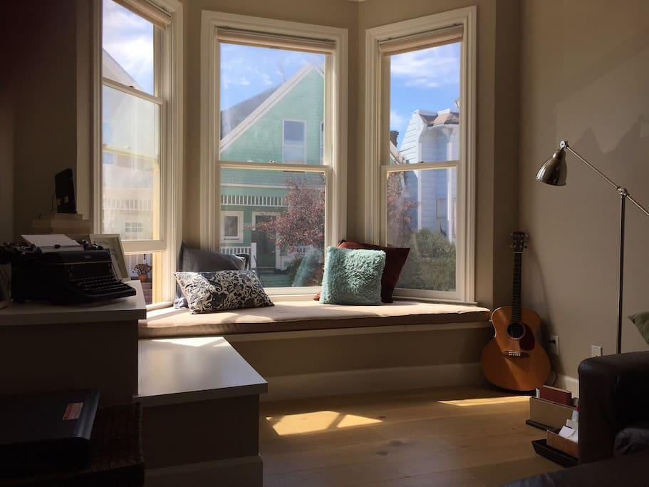 Cozy, sunny bay windows. Great reading nook!