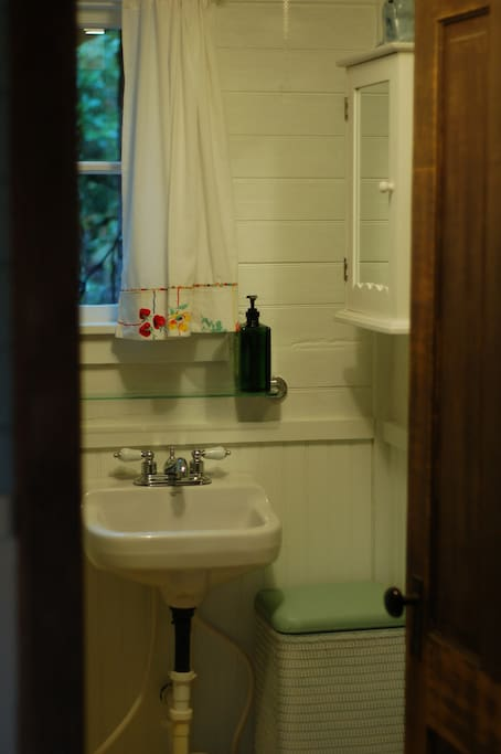 The Cabin features a full bath with a quaint claw-foot tub and shower.